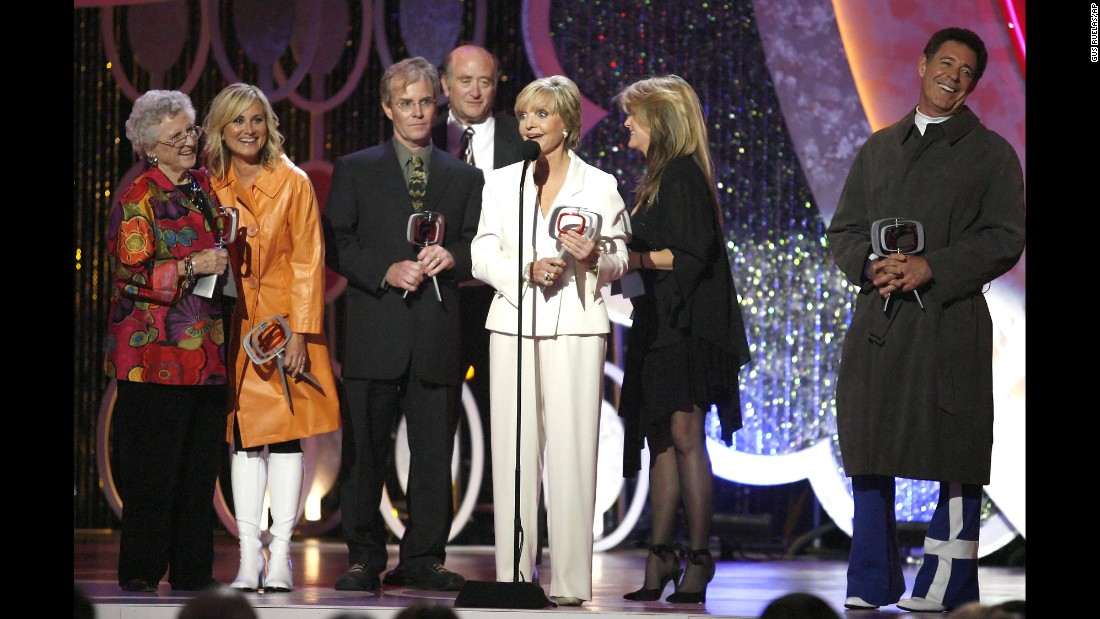 "Henderson accepts the Pop Culture Award with other former ""Brady Bunch"" cast members at the annual TV Land Awards in 2007. ""I created the kind of mother that I wished I'd had, and I think everyone longs for,"" Henderson once said of her iconic role."