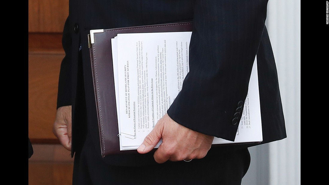 "A stack of papers, carried by Kansas Secretary of State Kris Kobach, faces the camera during a photo op with President-elect Donald Trump on Sunday, November 20. The papers <a href=""http://www.cnn.com/2016/11/21/politics/kris-kobach-donald-trump-department-of-homeland-security/"" target=""_blank"">appear to reveal Kobach's plans</a> for the Department of Homeland Security. Kobach's name has been floated as a potential pick to lead the department in Trump's Cabinet."