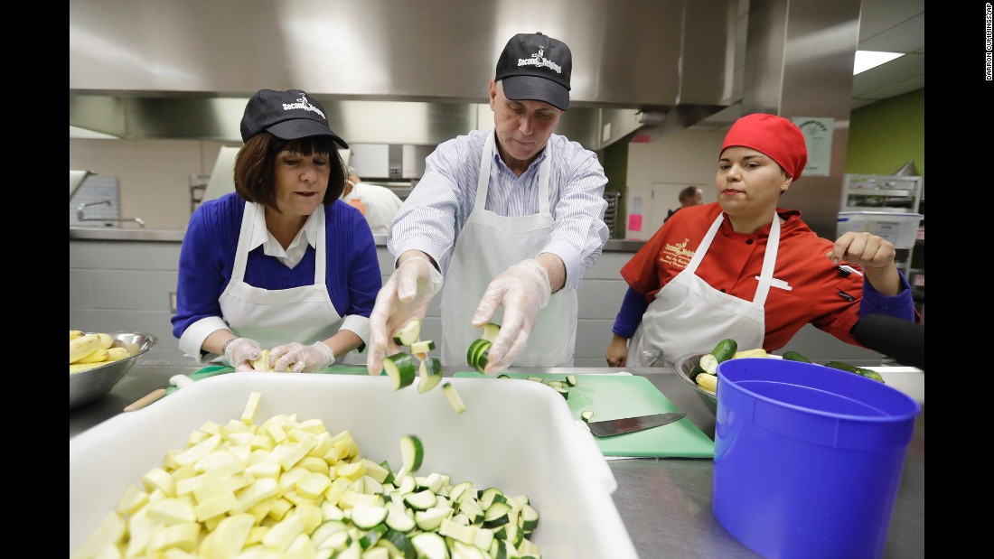 Vice President-elect Mike Pence and his wife, Karen, slice vegetables for Thanksgiving meals in Indianapolis on Wednesday, November 23.