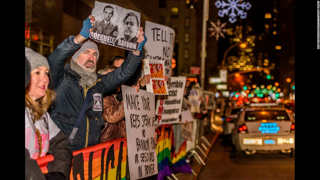 People protest Trump and some of his appointments in front of a Trump hotel in New York on Monday, November 21.