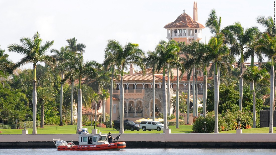 A US Coast Guard boat passes through the Mar-a-Lago resort where Trump was spending his Thanksgiving holiday in Palm Beach, Florida.