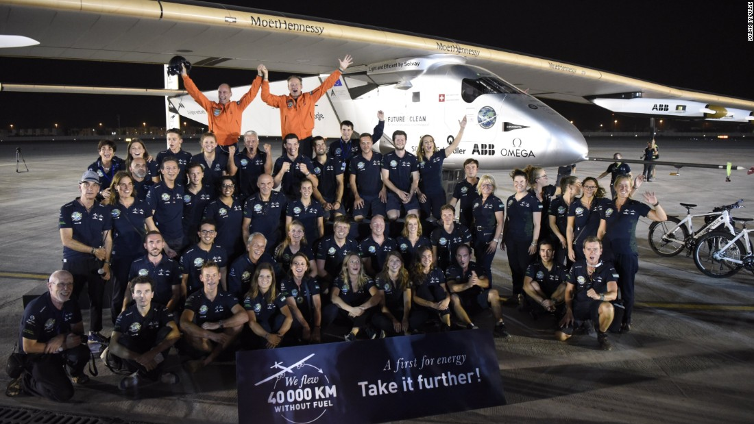The whole crew celebrate in Abu Dhabi after the landing.