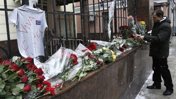 """A man places flowers at the Cuban Embassy in Moscow in memory of Castro on November 26. Russian President Vladimir Putin called the Cuban leader """"a sincere and reliable friend of Russia."""""""
