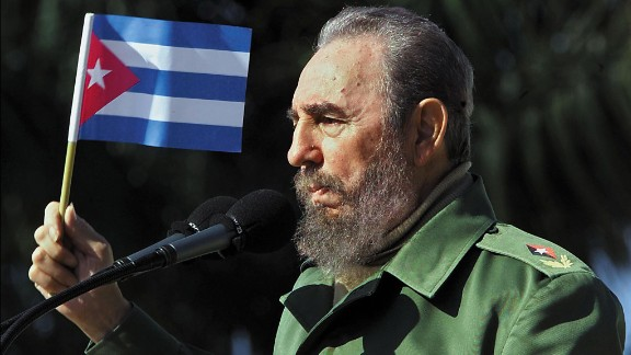 Cuban President Fidel Castro waves a flag during a visit on January 27, 2001 to the Havana neighborhood of San Jose de las Lajas. Castro died on Friday, November 25, 2016 at age 90.