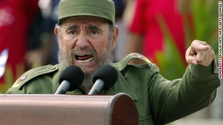"Habana, CUBA:  Cuban President Fidel Castro presides over a massive May Day demonstration at Havana's Plaza de la Revolucion (Revolution Square), 01 May 2005. A spokesman of Cuban President Fidel Castro read on Cuban National TV a document signed by Castro, 31 July 2006, by which he delegates power to his brother Raul Castro. Fidel Castro underwent surgery shortly after coming back from Mercosur?s Summit in Cordoba, Argentina. ""I do delegate, provisionally, my duties as first secretary of the Central Committee of the Communist Party in Cuba, to the second secretary, comrade Raul Castro Ruz,"" Castro said. AFP PHOTO/Adalberto ROQUE  (Photo credit should read ADALBERTO ROQUE/AFP/Getty Images)"