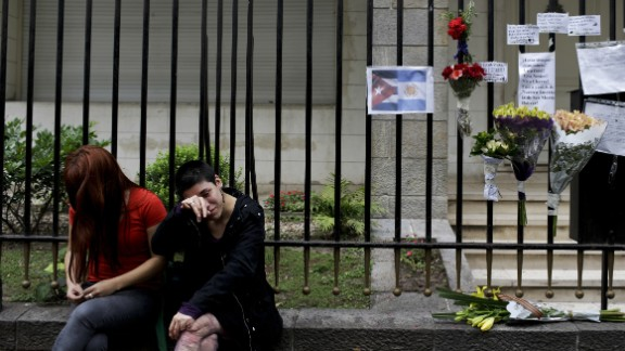 Women cry outside Cuba's embassy in Buenos Aires, Argentina, after the announcement of the death of Fidel Castro.