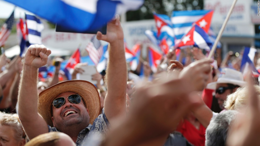 Members of the Cuban community in the Little Havana area in Miami react to the death of Fidel Castro on Saturday, November 26. Castro, who led a rebel army to improbable victory in Cuba, embraced Soviet-style communism and defied the power of US presidents during his half-century rule, died at age 90.