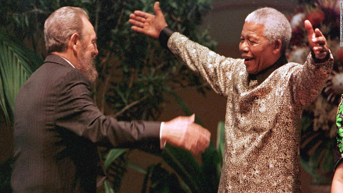 South African President Nelson Mandela greets Cuban leader Fidel Castro as he arrives for the opening of the 12th Non-Aligned Movement summit in Durban on September 2, 1998