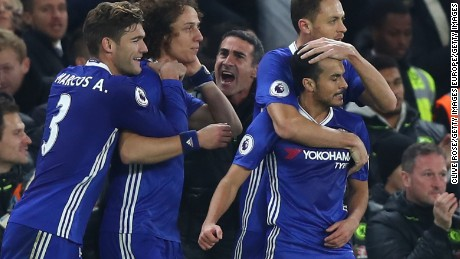 Pedro (far right) is congratulated after scoring his team's first goal in the 2-1 win over Tottenham Hotspur at Stamford Bridge.