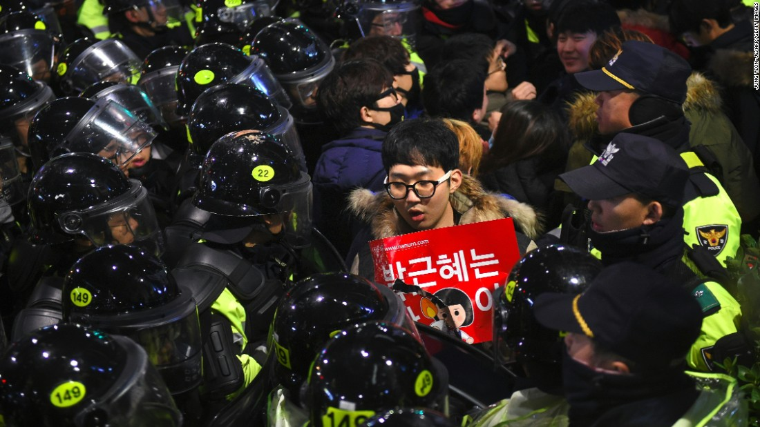 "Riot police and protesters engaged in a shoving match as the protesters attempted to march toward the presidential Blue House. (Read the full story <a href=""http://edition.cnn.com/2016/11/26/asia/south-korea-mass-protests/index.html"" target=""_blank"">here</a>)"