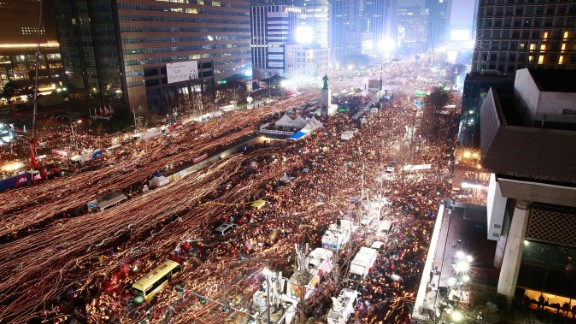 Thousands of South Koreans take to  the streets of Seoul to demand President Park Geun-Hye step down on November 26, 2016 in South Korea. (Read the full story here)