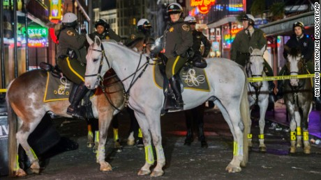 A mounted sheriff's patrol blocks off a crime scene after Sunday's fatal shooting.