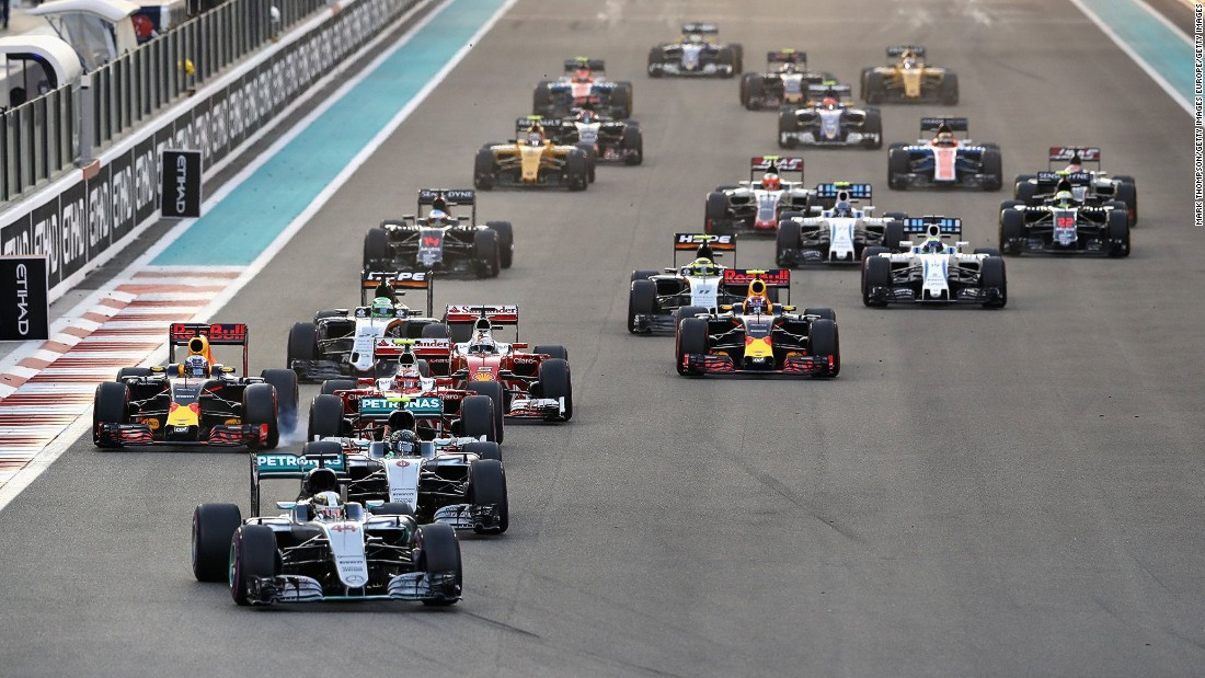 Lewis Hamilton leads from Mercedes teammate Nico Rosberg heading into the first corner at the start of the Abu Dhabi Grand Prix.