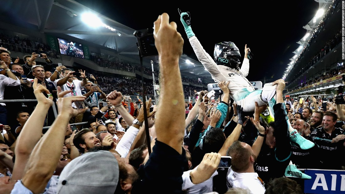 The moment of triumph: Nico Rosberg finishes second behind Lewis Hamilton in Abu Dhabi to secure a first world title -- 34 years after his dad, Keke, won his.