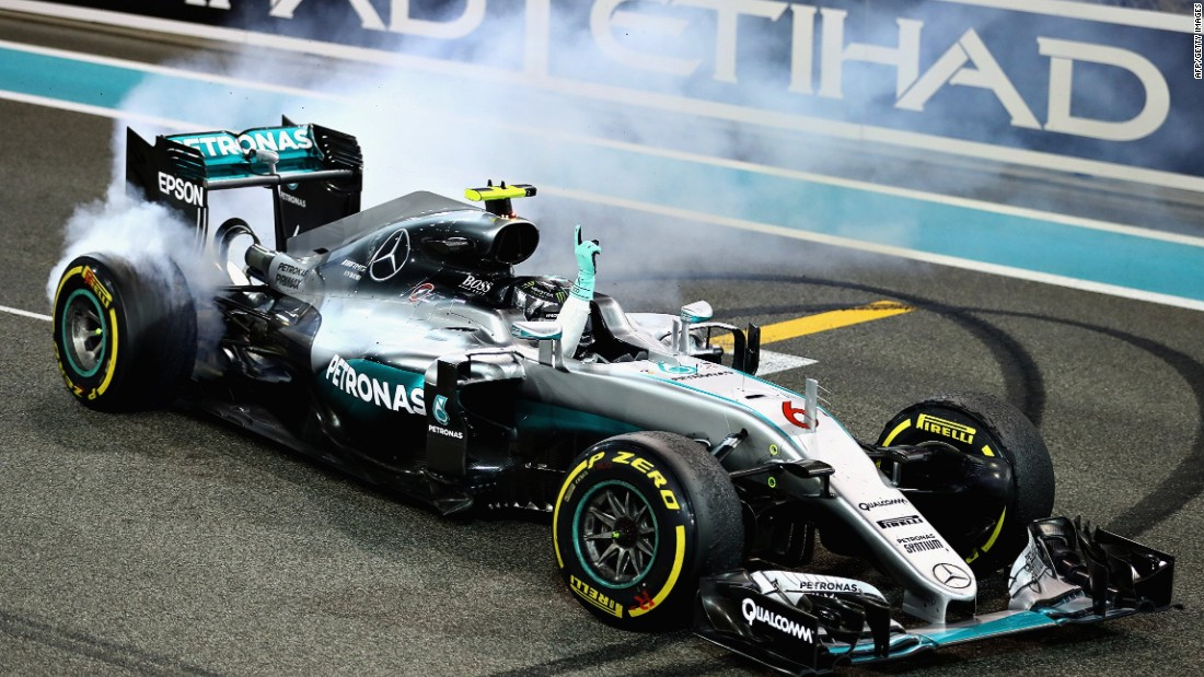 Rosberg celebrates after the Abu Dhabi Grand Prix in customary style, after asking his team permission to do wheelspins.