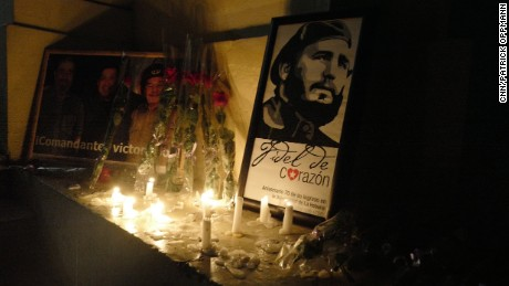 "Lights illuminate a photograph of Fidel Castro at the University of Havana, on Saturday, November 26, where Castro studied before starting the Cuban revolution. ""I am Fidel,"" students chanted."