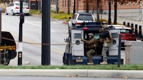 Members of the Columbus SWAT team work the scene around a parking garage after reports of a shooting on the campus of Ohio State University on Monday, Nov. 28, 2016, in Columbus, Ohio. (AP Photo/Jay LaPrete)