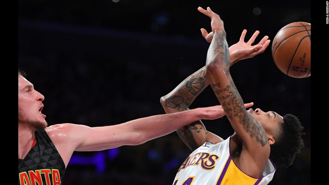 Atlanta's Mike Muscala blocks Brandon Ingram's shot during an NBA game in Los Angeles on Sunday, November 27.