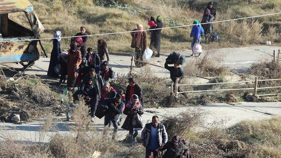 This photo provided by the Rumaf, a Syrian Kurdish activist group, which has been authenticated based on its contents and other AP reporting, In this Sunday, Nov. 27, 2016 photo, shows people fleeing rebel-held eastern neighborhoods of Aleppo into the Sheikh Maqsoud area that is controlled by Kurdish fighters, Syria. Syrian state media is reporting that government forces have captured the eastern Aleppo neighborhood of Sakhour, putting much of the northern part of Aleppo's besieged rebel-held areas under state control. (The Rumaf via AP)