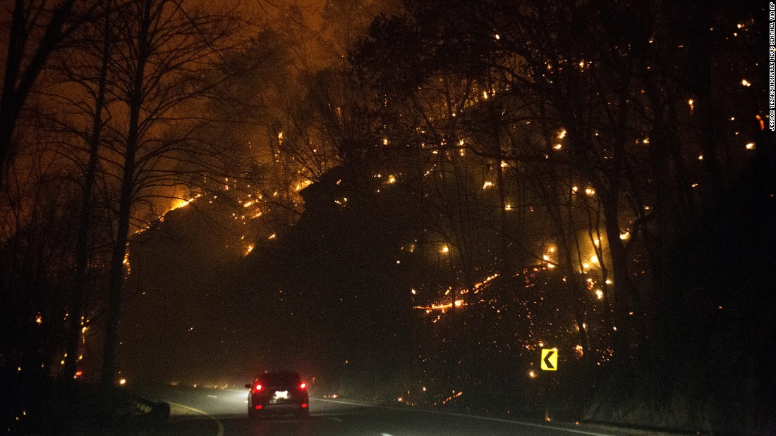 Fires burn on both sides of Highway 441 between Gatlinburg and Pigeon Forge on Monday, November 28.