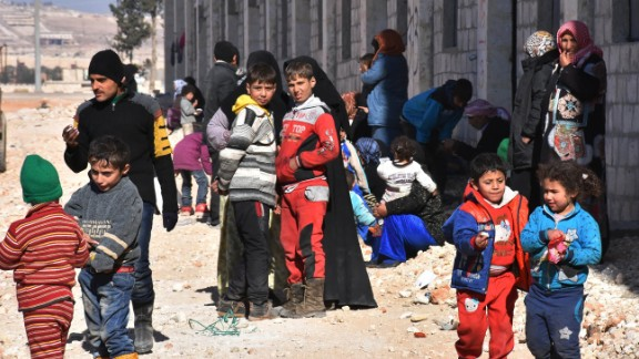 Displaced Syrian families at a camp in government-held Jibreen in Aleppo on Sunday.