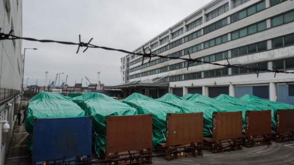 Armored vehicles belonging to the Singapore military seen covered with tarpaulin in Hong Kong.