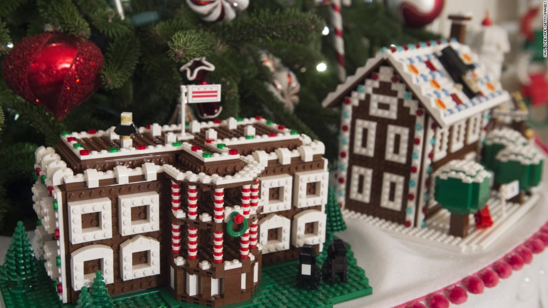 christmas trees and holiday decorations including lego houses from each state are displayed in the