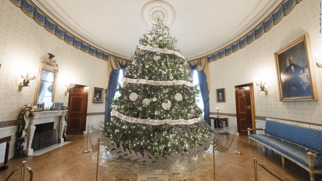 The White House Christmas Tree is lit up in the Blue Room on November 29, 2016.
