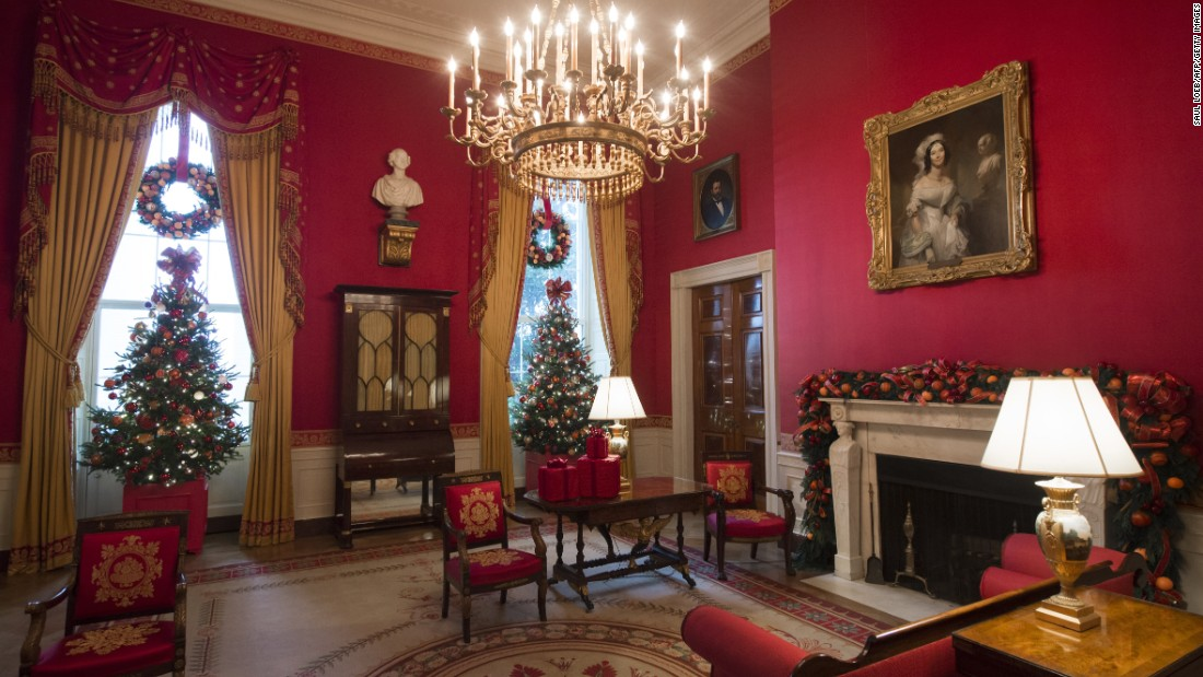 Christmas trees and wreaths peek out the windows of the Red Room on November 29, 2016.