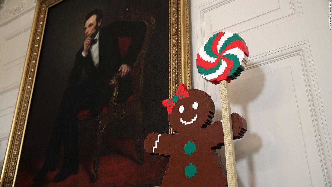 A gingerbread woman guards the framed portrait of Abraham Lincoln in the State Dining Room on November 29, 2016.