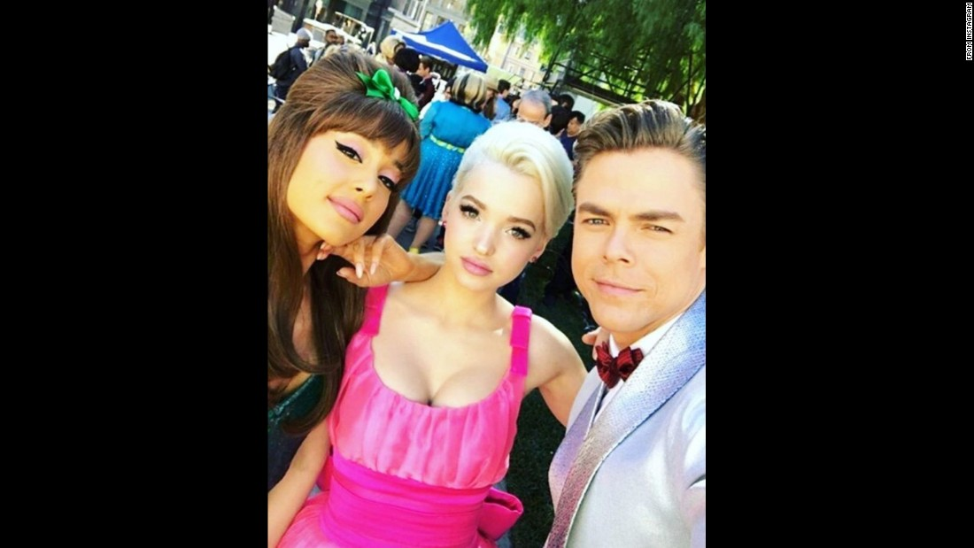 "Dancer Derek Hough <a href=""https://www.instagram.com/p/BM93feBhFhS/"" target=""_blank"">takes a selfie</a> with pop star Ariana Grande, left, and actress Dove Cameron on Friday, November 18. They'll be starring in the upcoming TV show ""Hairspray Live!"""