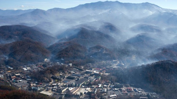 An aerial photo shows Gatlinburg, Tennessee, on Tuesday, November 29 -- a day after wildfires hit the city. Gatlinburg city officials declared mandatory evacuations in several areas as firefighters battled at least 14 fires in and around the city. More than 30 large wildfires have left a trail of destruction through North Carolina, South Carolina, Georgia, Tennessee, Alabama and Kentucky, according to the US Forest Service.