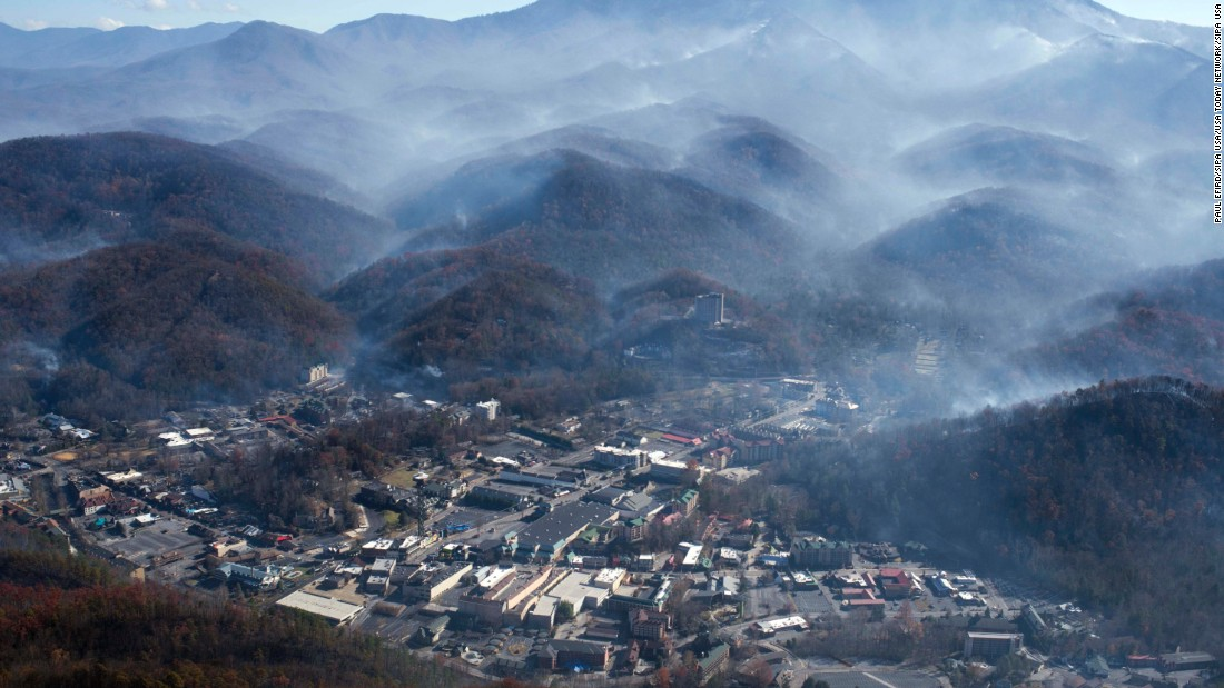 "An aerial photo shows Gatlinburg, Tennessee, on Tuesday, November 29 -- a day after wildfires hit the city. Gatlinburg city officials declared mandatory evacuations in several areas as <a href=""http://www.cnn.com/2016/11/28/us/southern-fires-gatlinburg-smokies/index.html"" target=""_blank"">firefighters battled at least 14 fires </a>in and around the city. <a href=""http://www.cnn.com/2016/11/14/us/southern-wildfires/"" target=""_blank"">More than 30 large wildfires</a> have left a trail of destruction through North Carolina, South Carolina, Georgia, Tennessee, Alabama and Kentucky, according to the US Forest Service."