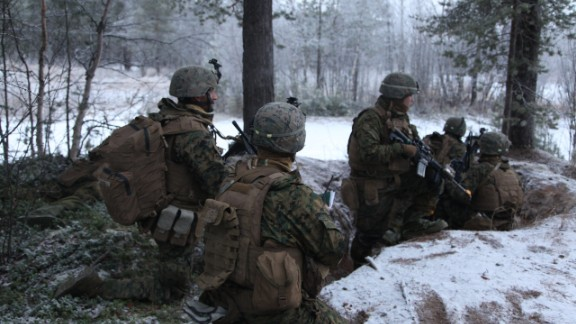 """US Marines advance towards their target -- a bunker manned by Norwegian allies playing the role of """"the enemy."""""""