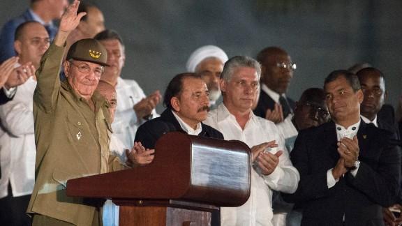 Cuban President Raul Castro, left, Nicaraguan President Daniel Ortega, center, and Ecuadorian President Rafael Correa, far right, take part in the Revolution Square rally on November 29.