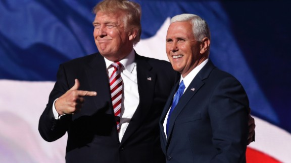 CLEVELAND, OH - JULY 20:  Republican presidential candidate Donald Trump stands with Republican vice presidential candidate Mike Pence and acknowledge the crowd on the third day of the Republican National Convention on July 20, 2016 at the Quicken Loans Arena in Cleveland, Ohio. Republican presidential candidate Donald Trump received the number of votes needed to secure the party's nomination. An estimated 50,000 people are expected in Cleveland, including hundreds of protesters and members of the media. The four-day Republican National Convention kicked off on July 18.  (Photo by Chip Somodevilla/Getty Images)