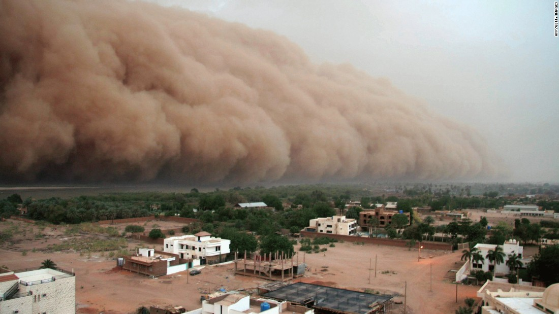 "A gigantic cloud of dust known as ""Haboob"" advances over Sudan's capital, Khartoum. Moving like a thick wall, it carries sand and dust burying homes, while increasing evaporation in a region that's struggling to preserve water supplies. <a href=""http://edition.cnn.com/2016/12/07/africa/sudan-climate-change/index.html"">Experts say</a> that without quick intervention, parts of the African country -- one of the most vulnerable in the world -- could become uninhabitable as a result of climate change."