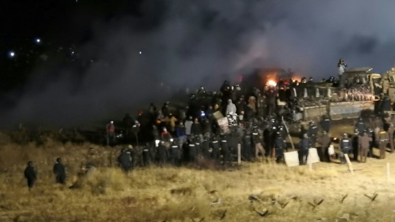 In this image provided by the Morton County Sheriff's Department, law enforcement and protesters clash near the pipeline site on Sunday, November 20.