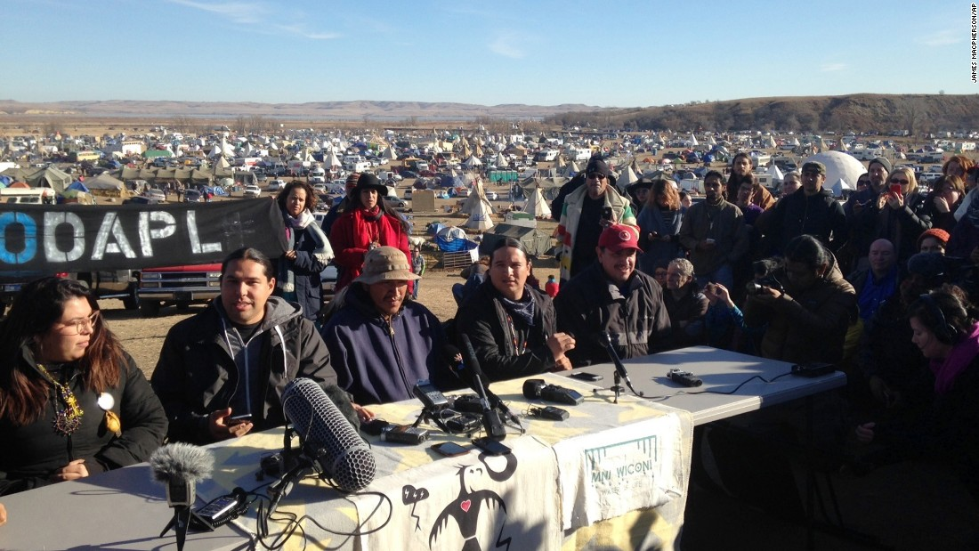 People against the construction of the Dakota Access Pipeline speak at a news conference near Cannon Ball on Saturday, November 26.