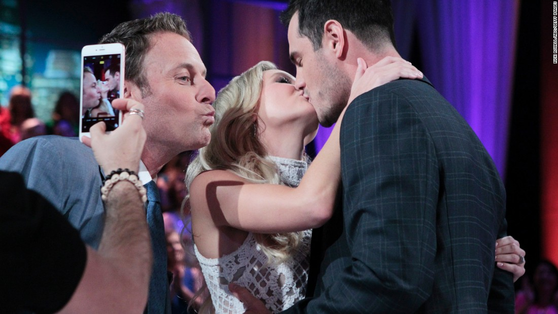 "Chris Harrison, host of ""The Bachelor,"" makes a kissy face in front of Ben Higgins and his new fiancee, Lauren Bushnell, after <a href=""http://www.cnn.com/2016/03/15/entertainment/ben-higgins-the-bachelor-feat/index.html"" target=""_blank"">the show's finale</a> on Monday, March 14."