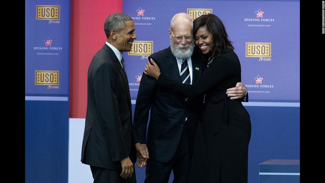 Former talk-show host David Letterman hugs first lady Michelle Obama during a USO comedy show in Maryland on Thursday, May 5. The Obamas were on hand to celebrate the fifth anniversary of the Joining Forces initiative, which helps military families.