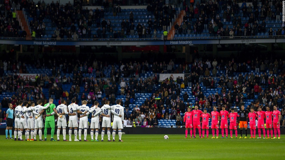 Soccer players from Real Madrid and Cultural Leonesa observe a minute of silence in Madrid to pay tribute to those killed in the crash.