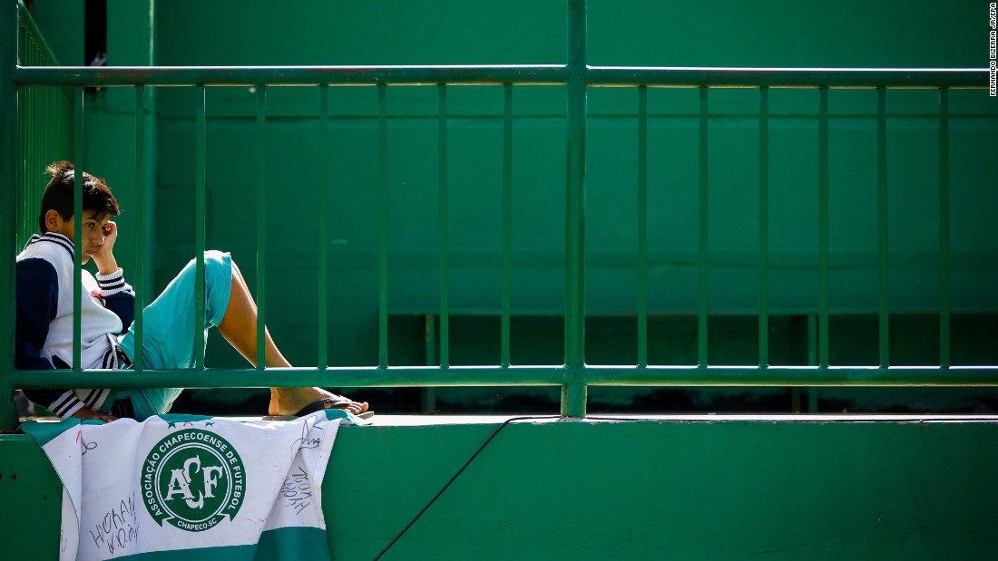 A child with a Chapecoense flag attends a vigil at the team's stadium in Brazil on November 30.