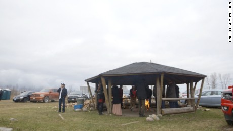 Guests gather at the sacred fire during a break at the Turtle Lodge gathering.