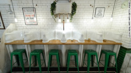 "TO GO WITH AFP STORY BY OUERDYA AIT ABDELMALEK Original urinals and cisterns are pictured in ""Attendant"", a former public toilet that has been converted into a coffee shop and sandwich bar in central London, on October 3, 2014. With spiralling land prices turning even the darkest corners of London into potential goldmines, the city's forgotten spaces, including 19th-century public toilets, are blossoming into restaurants, cafes and boutiques. Many Victorian urinals remained abandoned for decades after World War II, but encouraged by local officials keen for fresh sources of income, the conversion wave is gathering pace. AFP PHOTO/LEON NEAL        (Photo credit should read LEON NEAL/AFP/Getty Images)"