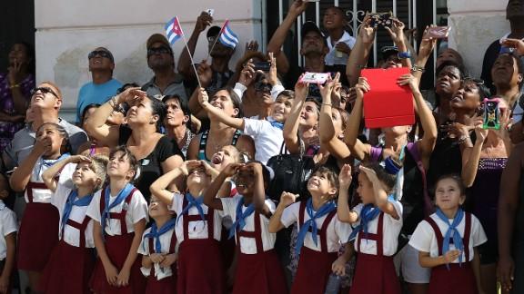 Schoolchildren react as a helicopter passes overhead in Cardenas, Cuba, on November 30.