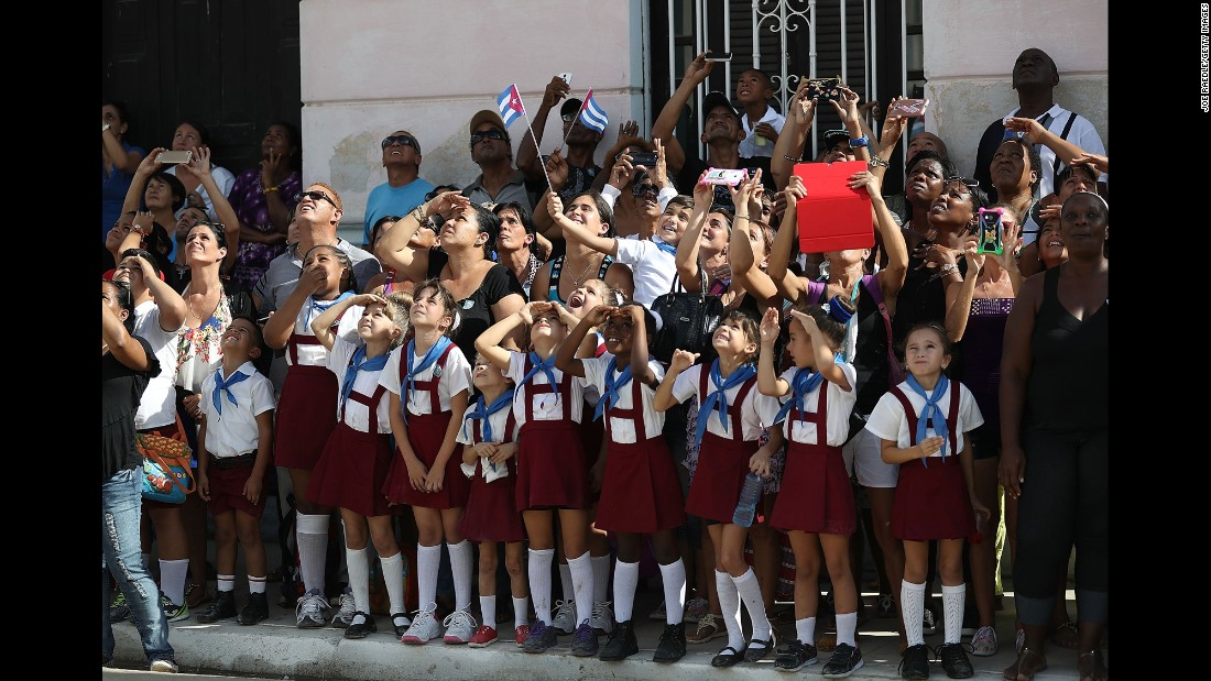 Schoolchildren react as a helicopter passes overhead in Cardenas, Cuba, on November 30.