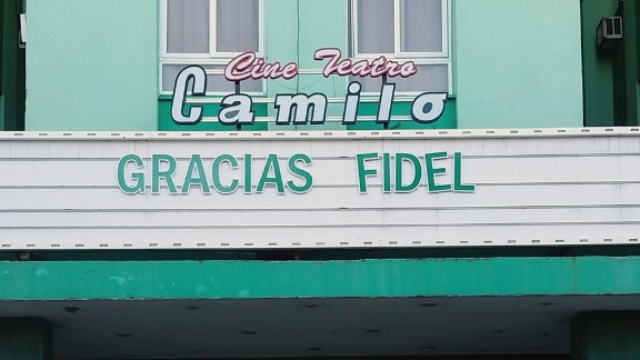 """People line up to pay their final respects at a Castro memorial in Santa Clara on November 30. The theater marquee reads """"Thank you Fidel"""" in Spanish."""