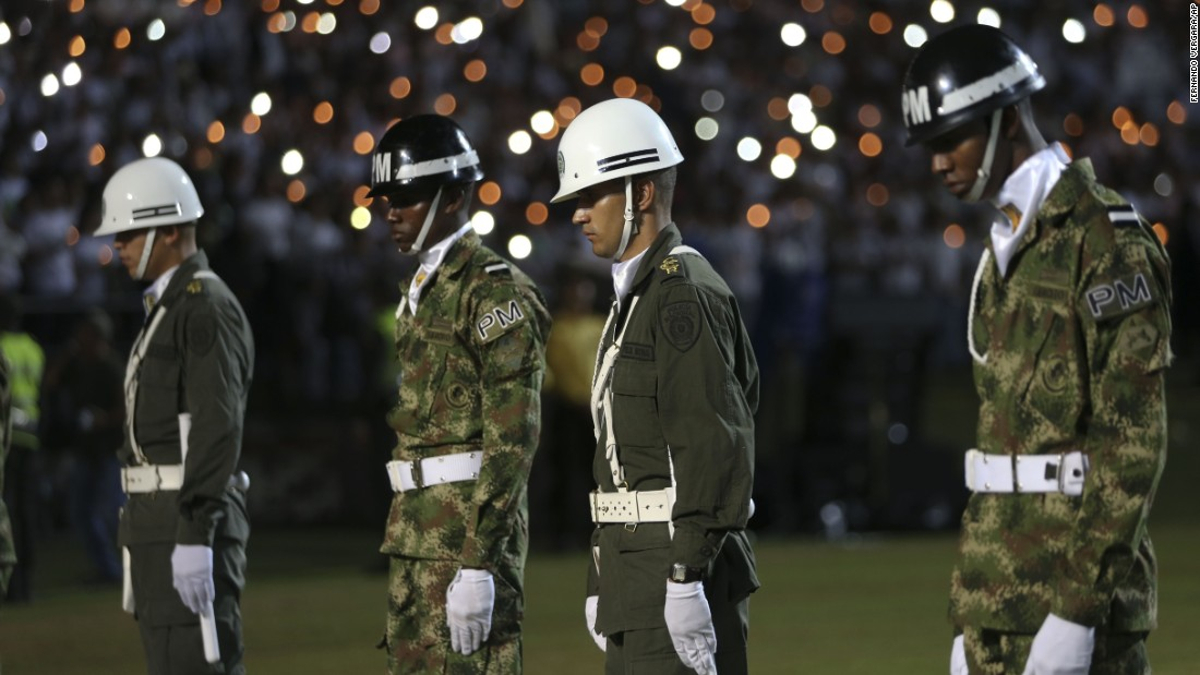 Soldiers and police attend the tribute in Medellin on November 30.