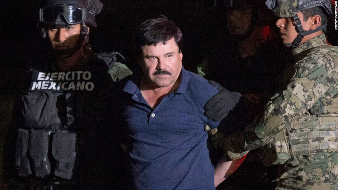 "<strong>January 8:</strong> Drug lord Joaquin ""El Chapo"" Guzman is escorted by soldiers at a federal hangar in Mexico City. Members of Mexico's navy caught Guzman <a href=""http://www.cnn.com/2016/01/08/americas/el-chapo-captured-mexico/"" target=""_blank"">in an early morning raid</a> in the coastal city of Los Mochis, a senior law enforcement official told CNN. Mexico <a href=""http://www.cnn.com/2016/01/09/americas/el-chapo-captured-mexico/"" target=""_blank"">planned to extradite Guzman to the United States, </a>where he faces drug trafficking charges connected to his cartel, authorities said. He had been on the run since escaping from a Mexican prison in July 2015."